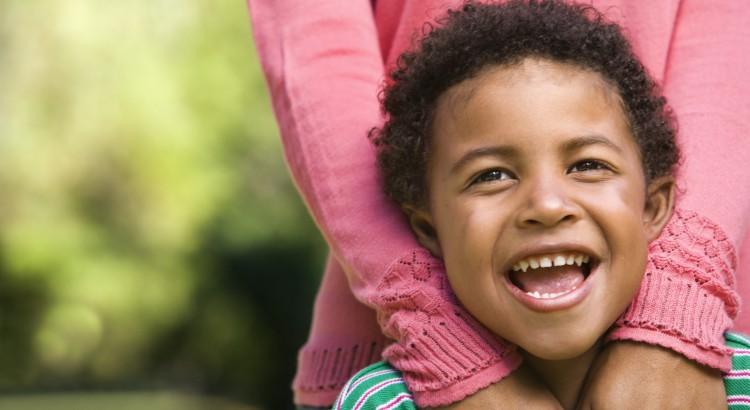 smiling kid with mum